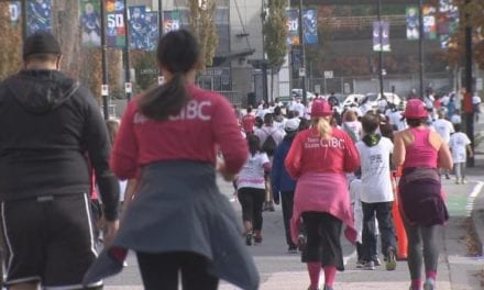 Vancouverites in hot pink accessories hit the streets to support breast cancer research | CBC News